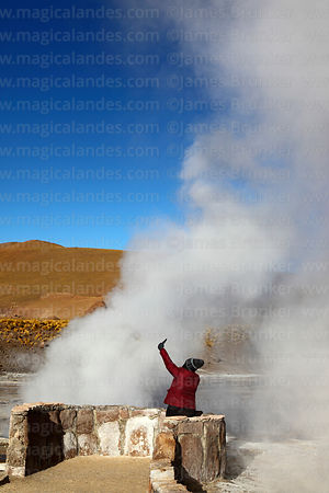 Tourist taking a selfie at the El Tatio geyser field, Region II, Chile