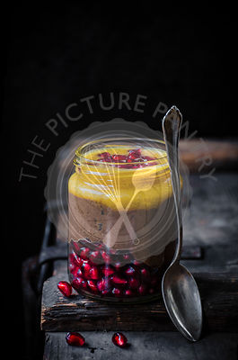 Blended chocolate chia pudding with orange and pomegranate.