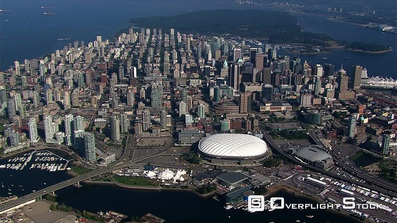 High, partial orbit of Vancouver, British Columbia, at a distance  BC Place stadium in center frame.