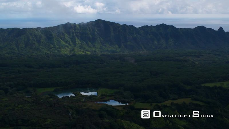 Over a shadowed valley and Mamalahoa Forest Reserve, Oahu.