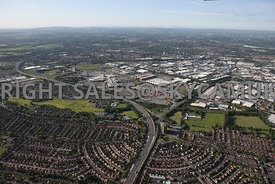 Manchester aerial photograph of the corridor of the M 60 motorway showing Junction 9 and the Parkway running into the Trafford Park Estate with the motorway snaking away to the north across the landscape with the hills in the distance