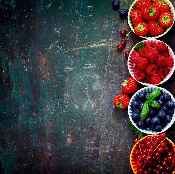 Fresh Berries on Wooden Background. Strawberries, Raspberries and Blueberries
