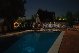 Night time view of the swimming pool of a Portugese villa
