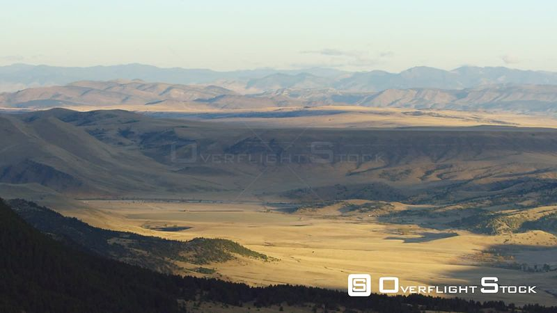Golden fields surround the Madison River in the mountains of southwestern Montana