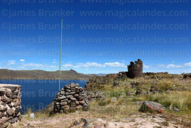 Lightning conductor, chulpas / burial towers and Lake Umayo, Sillustani, Peru