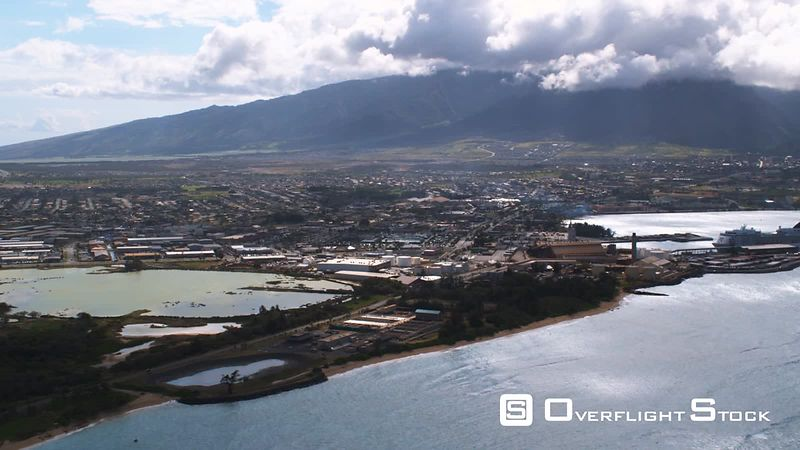 Wide view of Kahului, Hawaii, with cruise ship in harbor.
