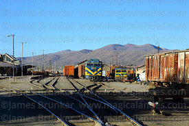 Hitachi Mitsubishi #955 diesel locomotive leaving Uyuni station with a goods train, Bolivia