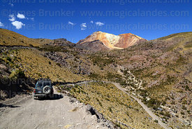 Toyota Land Cruiser on dirt track below Tunupa volcano, Oruro Department, Bolivia