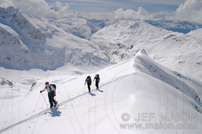 Off-piste skiers on a ridge