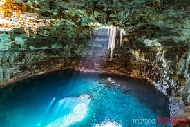 Blue Cenote with sunlight from the top, Yucatan, Mexico