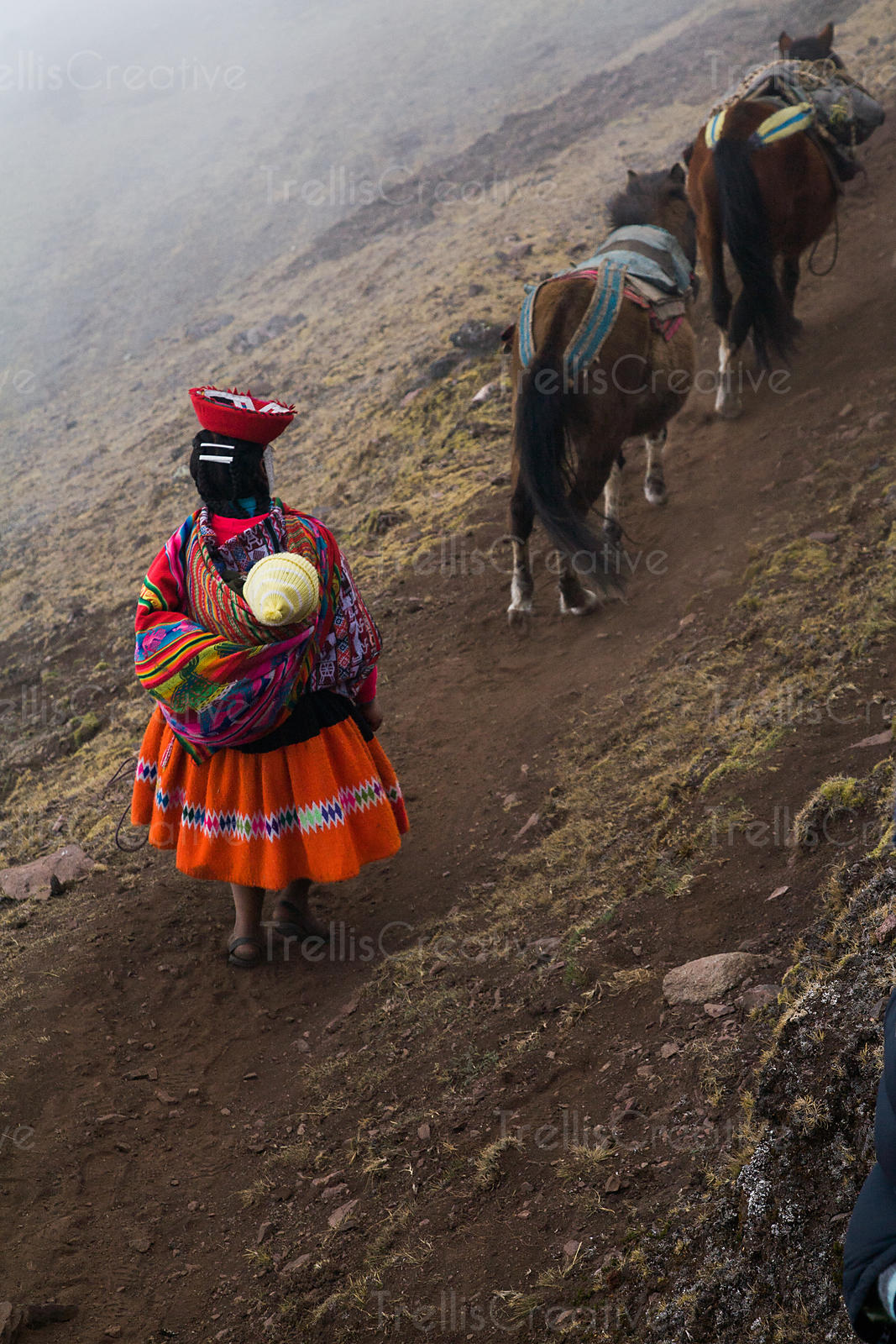 A young Andean woman and her baby, Lares Trek, Andes Mountains, Peru