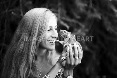 B+W smiling woman holding rat