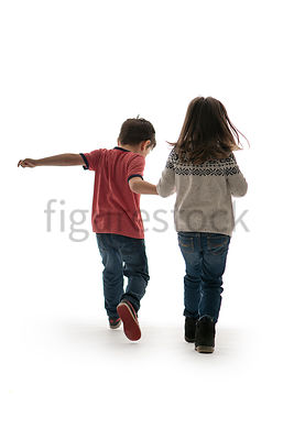 A Figurestock image of a little boy and girl, running and facing away – shot from eye level.