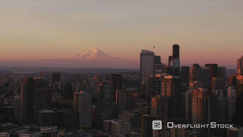 Seattle, Washington Aerial view of Seattle and Mt. Rainier at sunrise.  Shot with Cineflex and RED EpicW Helium.