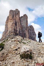 Hiker looking up at the three peaks Dolomites Italy