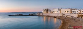 Panoramic of beach at dusk, Gallipoli, Salento, Apulia, Italy