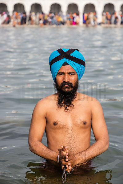 A Sikh Devotee Takes a Dip in the Sacred Pool at Anandpur Sahib