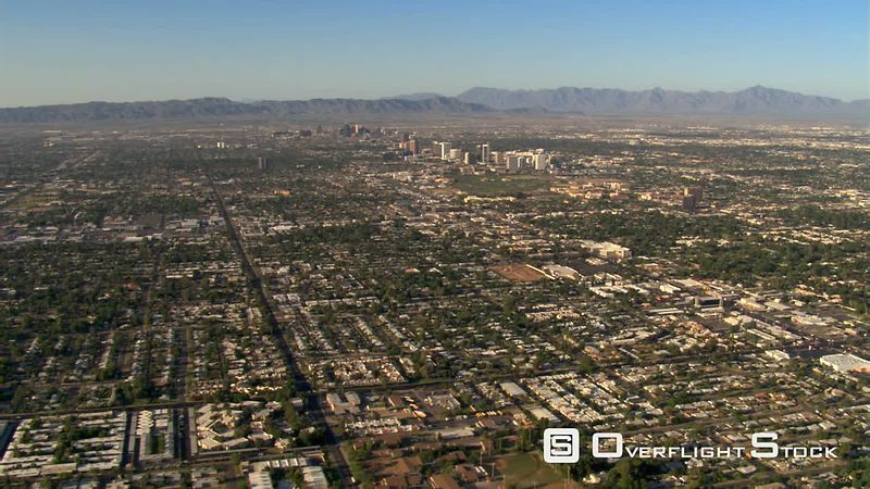 Wide approach toward downtown Phoenix over outlying areas.