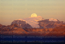 Full moon rising directly behind Mt Mururata (2 of a series of 4 images), Cordillera Real, Bolivia