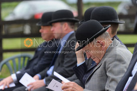 Visitors reading their hound lists - Cottesmore Hunt Puppy Show 2013