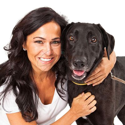 Woman Holding Happy Dog