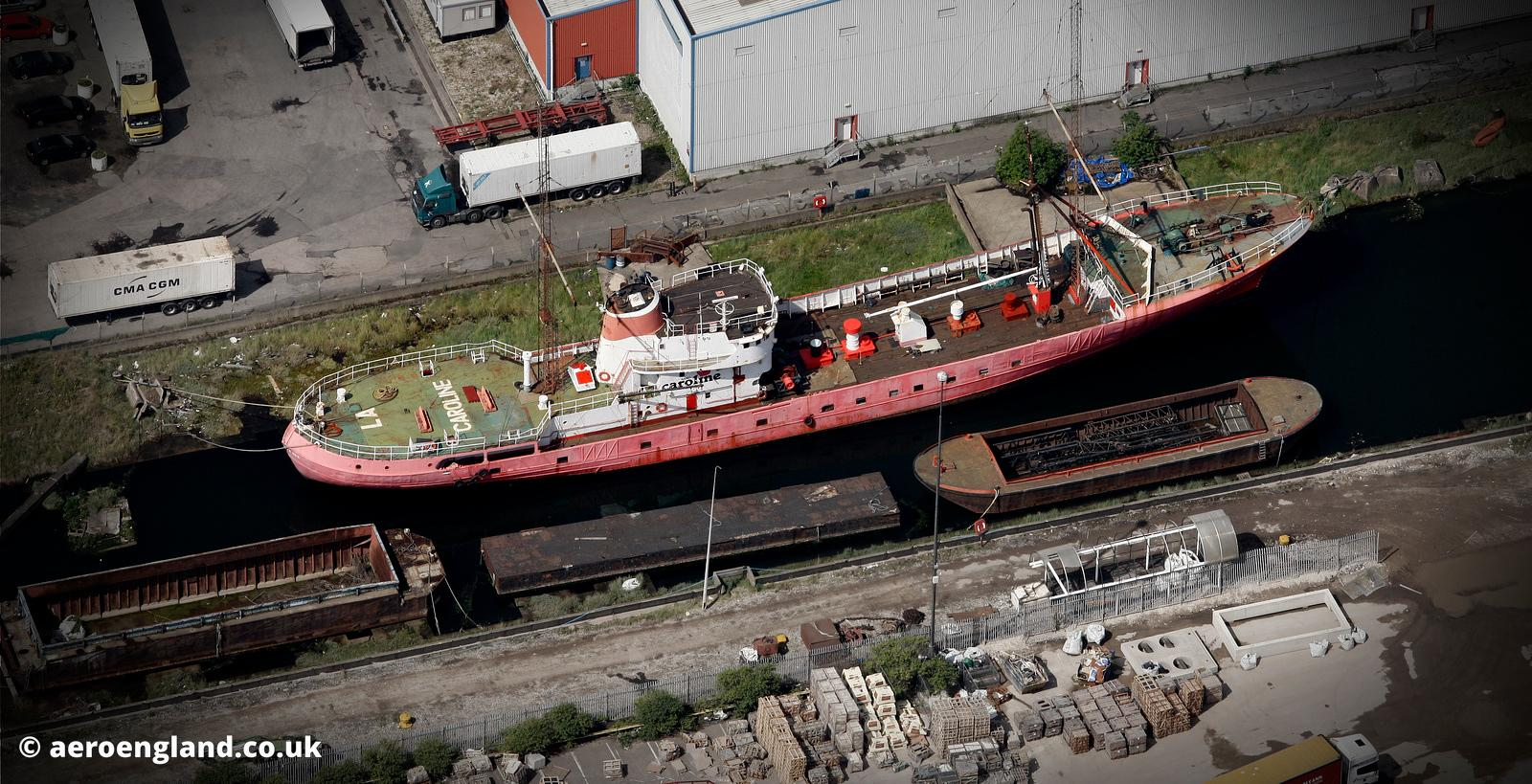 aerial photograph of the Ross Revenge, broadcasting ship used by Radio Caroline , taken in Tilbury Docks England