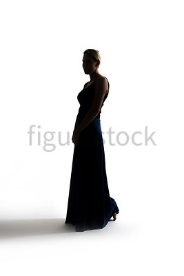 A Figurestock image of a blonde woman, in an evening dress, in silhouette - shot from mid level.