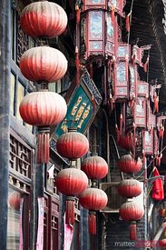 Red chinese lanterns hanging on a wall of Pingyao, China
