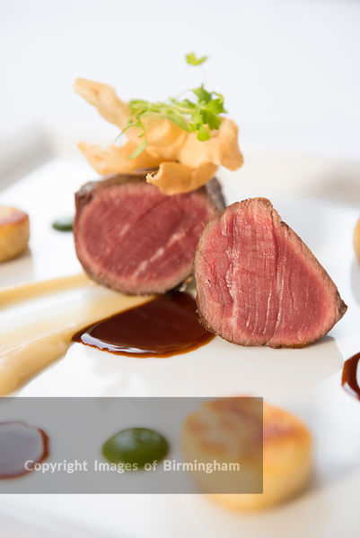 Roast beef plated in a fine dining restaurant