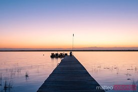 Sunset over jetty, laguna Bacalar, Mexico