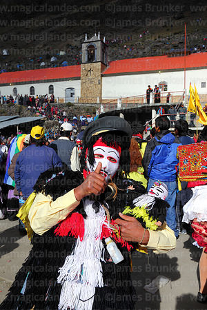 Masked Ukuku / Pablito / Pablucha dancer in front of Sanctuary during Qoyllur Riti festival, Peru