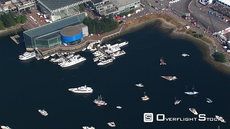 Aerial zoom-out of Vancouver, British Columbia, from False Creek harbor  BC Place in center frame.