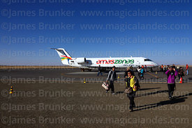 Asian tourists arriving on Amaszonas Canadair CL 600 2B19 Regional Jet CRJ 200LR at Uyuni airport, Bolivia