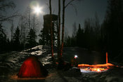 Winter camping under a full moon