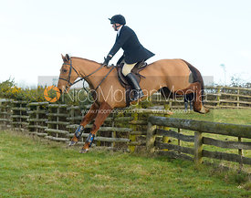 Henry Nicholson jumping a hunt jump at Hill Top Farm
