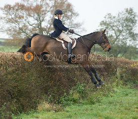 Katie Barber jumping a big hedge