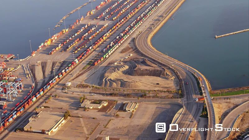 Aerial View Of Container Port With Rail Terminal And Shunting (Also Called Switching) Yard At Beginning Of Clip. Note Length Of Trains. RED R3D 4k California