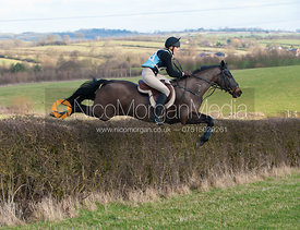 Katie Barber jumping a hedge early on the course