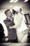 Married couple kissing during the ceremony