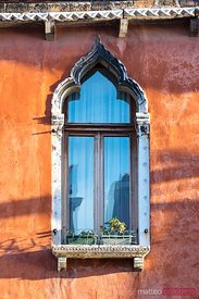 Typical ornate window in the town of Burano, Venice, Italy
