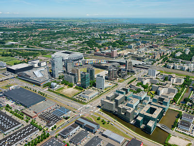 Business and office area Arenapoort,  with Plaza Arena and Atlas Arena (right), the football stadium the Johan Cruijff Arena (left) and he railway Station Amsterdam Bijlmer ArenA, Amsterdam,  Netherlands.