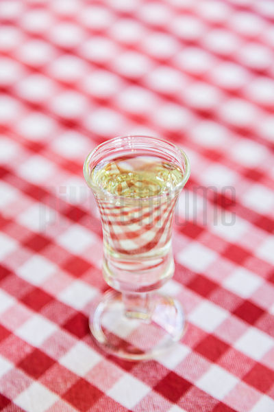 A Glass of Schnapps on a Gingham Table Cloth