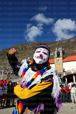Masked Kapac Qolla dancer in front of Sanctuary during Qoyllur Riti festival, Peru