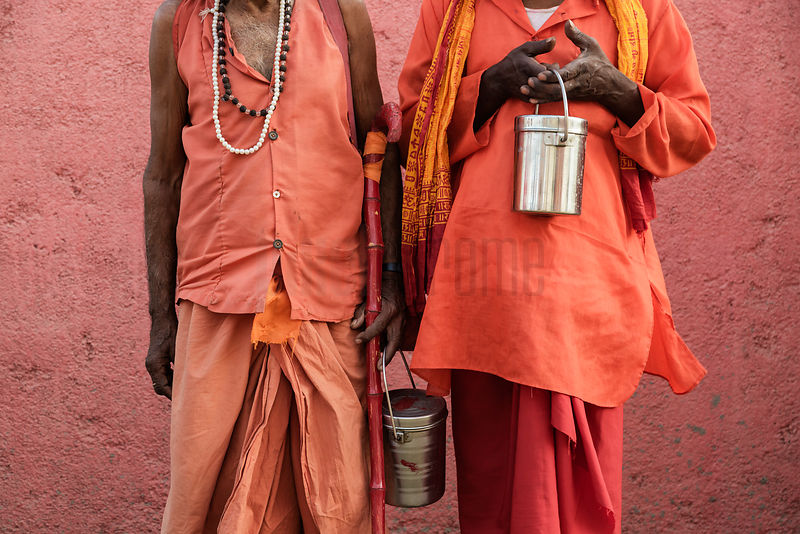 Closeup of Two Sadhus Holding their Tiffin Pots