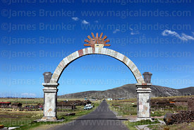 Sun symbol on stone archway on road to Atuncolla, Puno Region, Peru