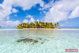 Island in the blue lagoon of Rangiroa atoll, French Polynesia