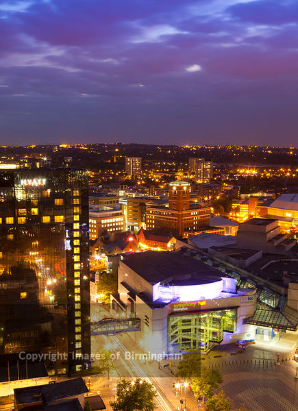 Cityscape of Broad Street district, Birmingham at night, England, UK
