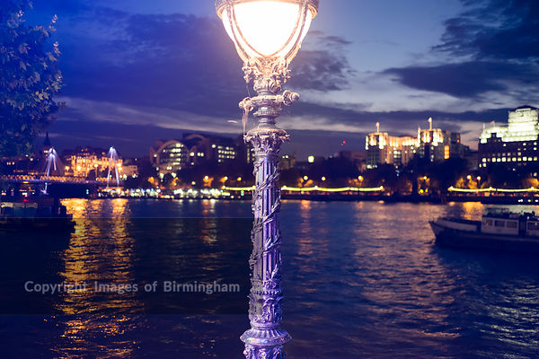The river Thames and street lamp, London at night.