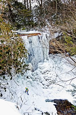A Hiker Climbs Cucumber Falls In Winter- Ohiopyle, PA