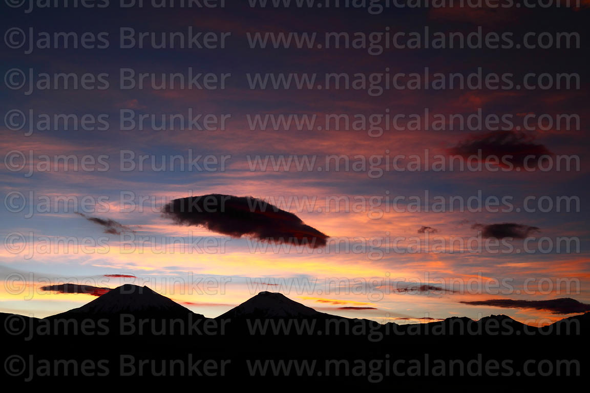 Silhouettes of Payachatas volcanos at sunset, Sajama National Park, Bolivia